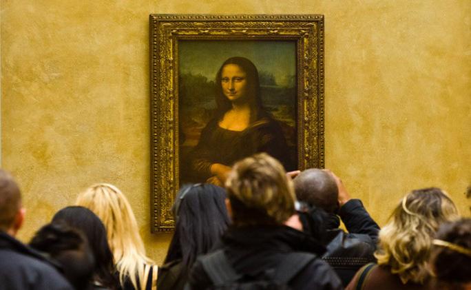 Vẻ đẹp lạ của Mona Lisa là do… bị suy giáp, mỡ máu? - Ảnh 1.