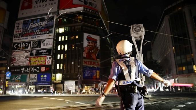 Nhật Bản: Động đất mạnh, hàng trăm cuộc gọi báo người mất tích - Ảnh 2.