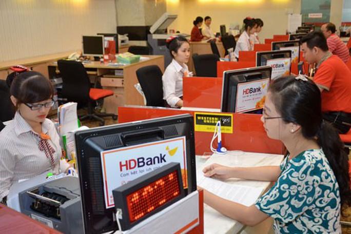 Nhiều ngân hàng lãi lớn - Ảnh 1.