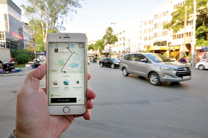 Có nên quy định giá trần, giá sàn cho Uber, Grab? - Ảnh 2.