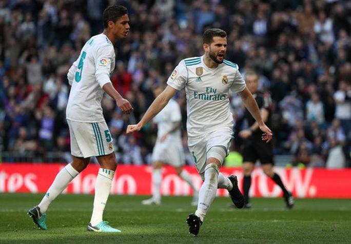 Ronaldo ghi bàn trở lại, Real Madrid đốt nóng đường đua La Liga - Ảnh 1.