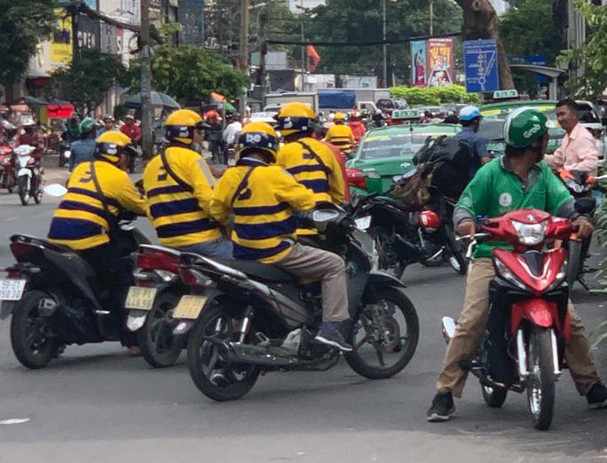Ứng dụng gọi xe công nghệ đua khuyến mại để kéo khách, tài xế - Ảnh 2.
