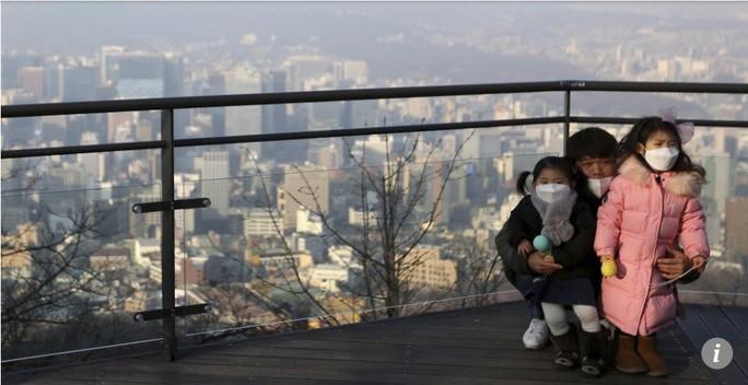 Châu Á nghẹt thở vì bụi mù - Ảnh 1.