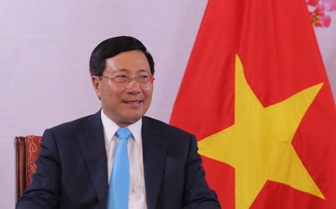 Phó Thủ tướng Phạm Bình Minh nói về quan hệ Việt - Mỹ trước những biến động - Ảnh 1.