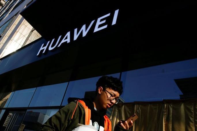 Mỹ bồi thêm đòn vào Huawei  - Ảnh 1.