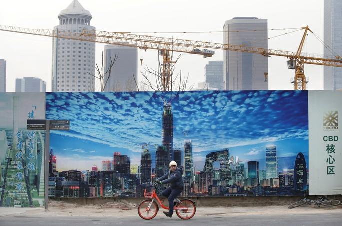 Kinh tế Trung Quốc chịu nhiều sức ép - Ảnh 1.
