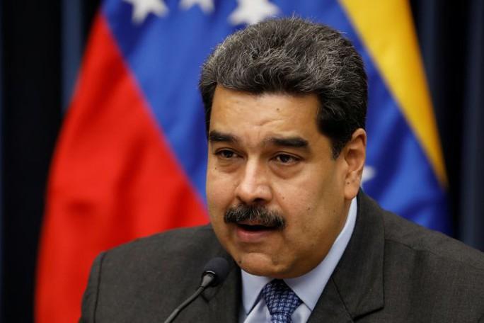 Venezuela cắt đứt quan hệ ngoại giao với Mỹ - Ảnh 1.