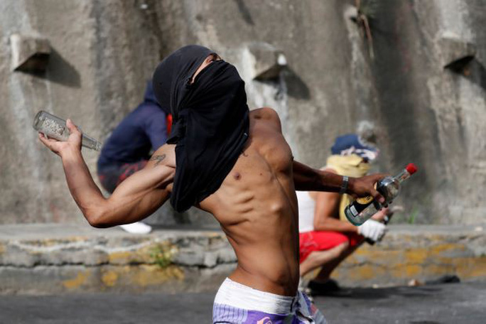 Hành trình rơi vào khủng hoảng của Venezuela - Ảnh 2.