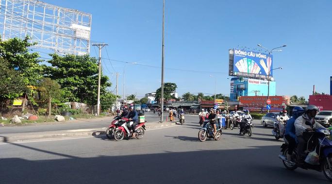 Thai phụ tử vong thương tâm dưới gầm xe tải ở ngã tư Bình Phước - Ảnh 2.