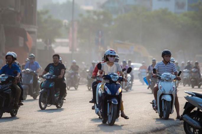 Bộ Tài nguyên-Môi trường khuyến cáo về nồng độ bụi PM2.5 ở Hà Nội, TP HCM bị ô nhiễm - Ảnh 1.