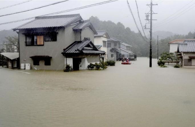 Nhật Bản ngụp lặn trong biển lũ do bão Hagibis - Ảnh 7.