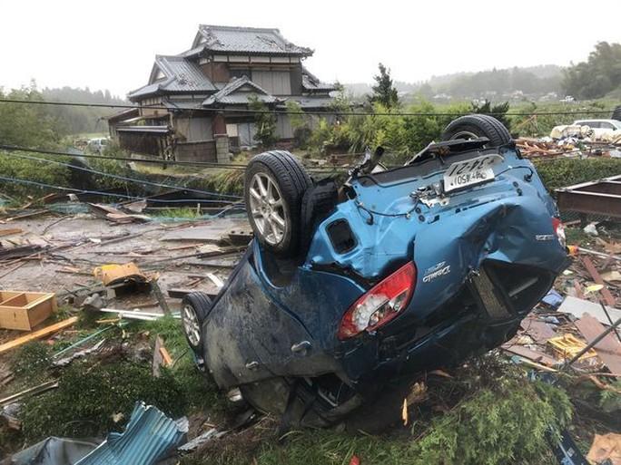 Nhật Bản ngụp lặn trong biển lũ do bão Hagibis - Ảnh 10.