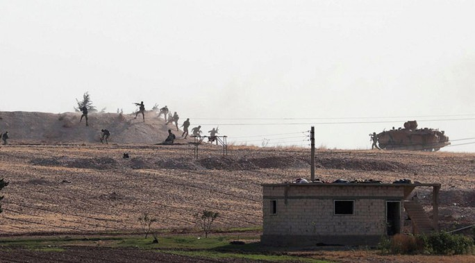 Mỹ rút quân, quân đội Syria tới miền Bắc đối đầu Thổ Nhĩ Kỳ - Ảnh 1.
