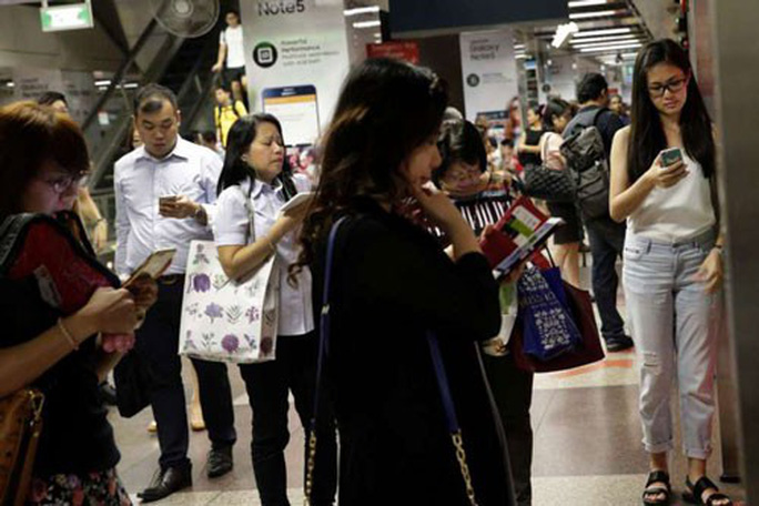 Singapore mạnh tay với tin giả - Ảnh 1.