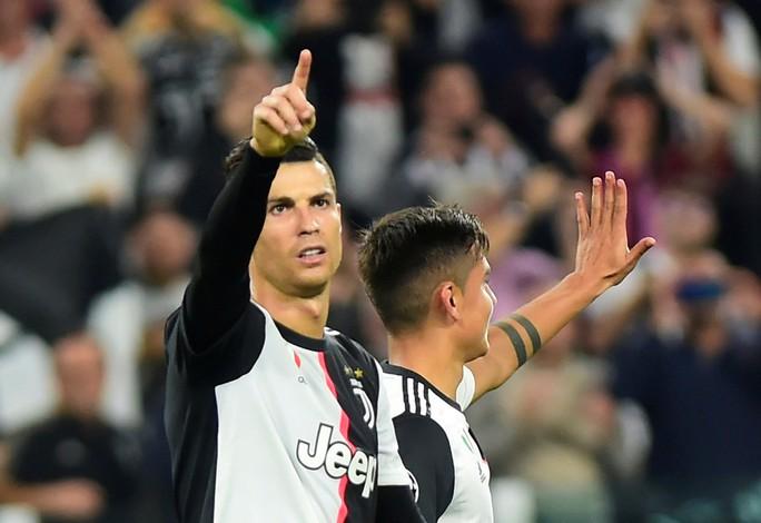 Ronaldo lập kỷ lục ghi bàn, xóa hiềm thù với Higuain - Ảnh 7.