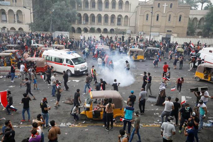 Iraq: An ninh nổ súng vào người biểu tình, 879 người thương vong - Ảnh 1.