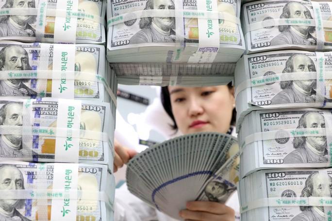 Các siêu cường đe dọa vị thế đồng USD - Ảnh 1.
