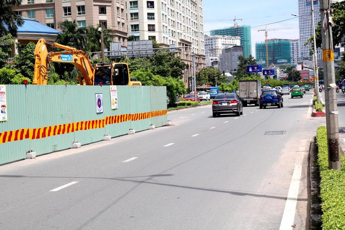 Bắt đầu giải cứu rốn ngập Nguyễn Hữu Cảnh - Ảnh 2.