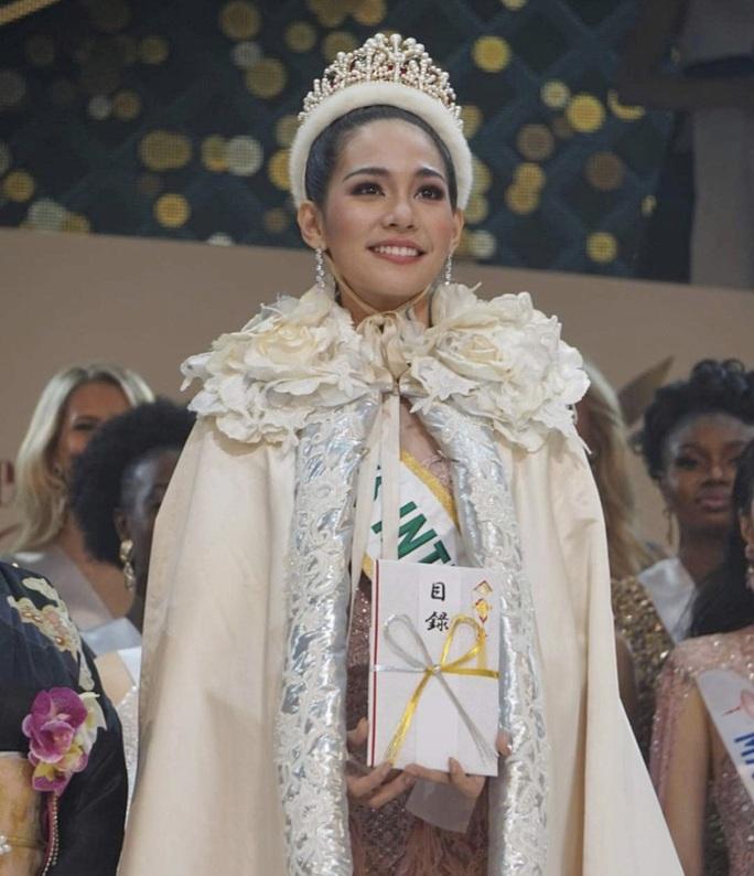 Nhan sắc rạng ngời của tân Hoa hậu Quốc tế - Ảnh 2.