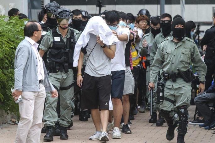 Vấn đề Hồng Kông càng làm xấu quan hệ Mỹ - Trung - Ảnh 1.
