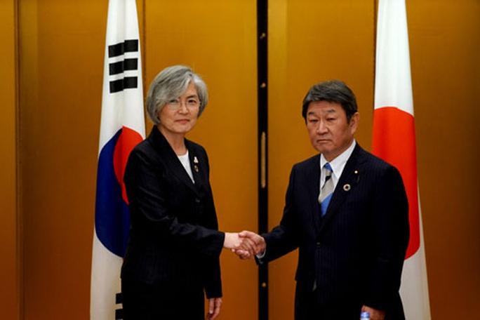 Nhật - Hàn nỗ lực phá băng quan hệ - Ảnh 1.
