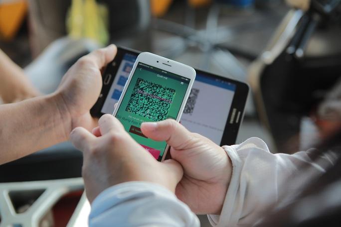 Bỏ quy định ví điện tử không được giao dịch quá 20 triệu đồng/ngày  - Ảnh 1.
