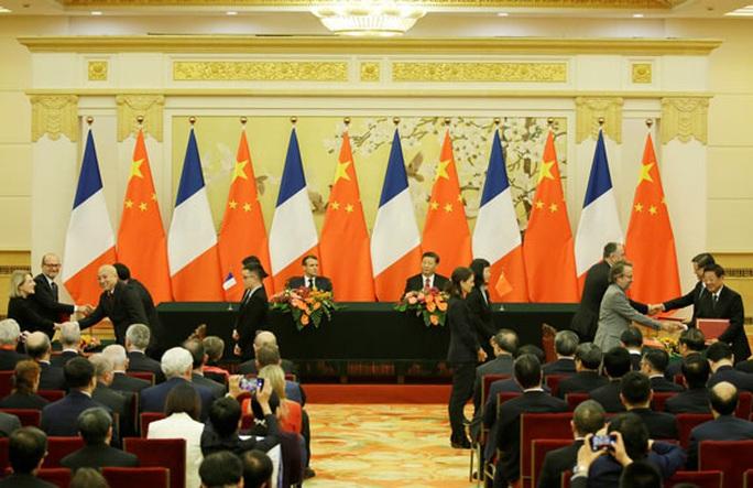 Giảm thương mại với Mỹ, Trung Quốc làm ăn với Pháp - Ảnh 1.