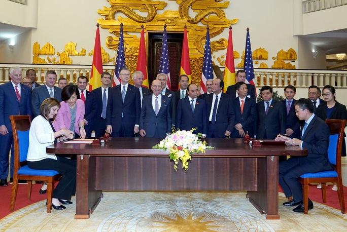 Việt - Mỹ ký kết 5 thỏa thuận kinh doanh lớn trị giá hàng tỉ USD - Ảnh 1.