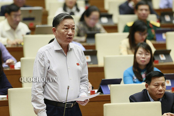 Bộ trưởng Tô Lâm và Bộ trưởng Nguyễn Mạnh Hùng trả lời về an ninh mạng, chống tội phạm mạng - Ảnh 2.