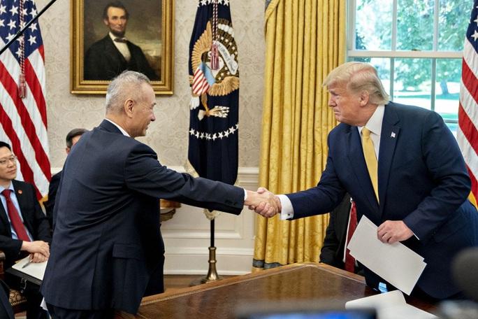 Ông Trump chưa kịp áp thuế bổ sung, thương chiến Mỹ - Trung có biến? - Ảnh 1.