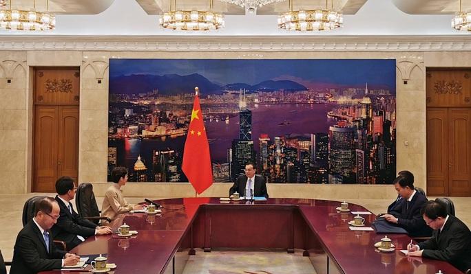 Bắc Kinh nhắc nhở lãnh đạo Hồng Kông chưa hoàn thành nhiệm vụ - Ảnh 3.
