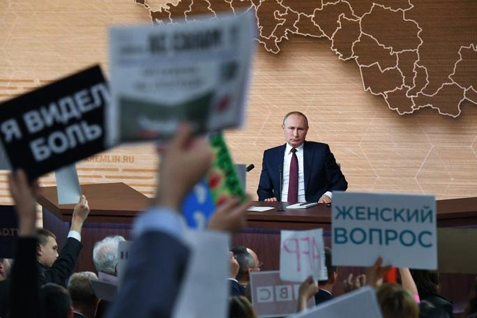 Ông Trump bị luận tội, ông Putin bênh chằm chặp - Ảnh 4.