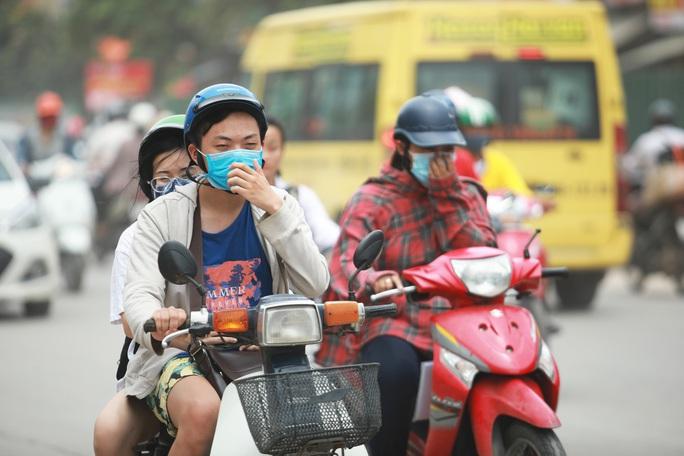 Họp khẩn bàn giải pháp chống ô nhiễm không khí ở Hà Nội và TP HCM - Ảnh 1.