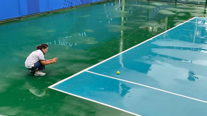 Lý Hoàng Nam và Daniel Cao Nguyễn chưa thể thi đấu vì bão đổ bộ - Ảnh 1.