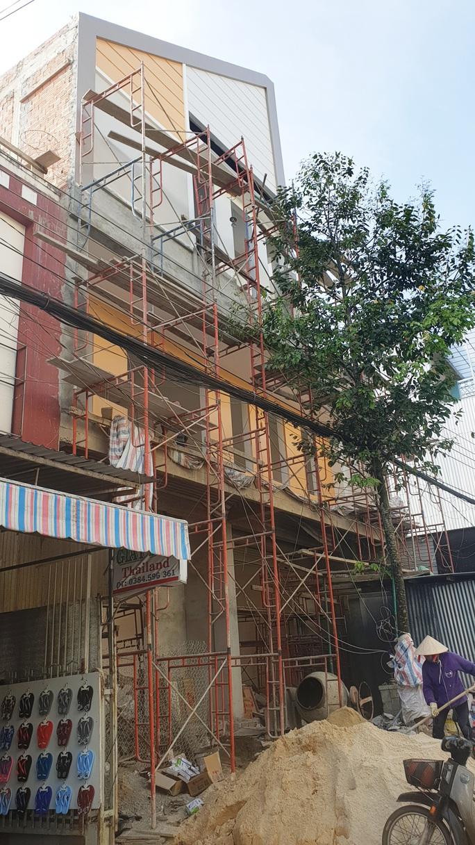 Vụ Giám đốc BHXH xây nhà sai phép: Dọa cắt cổ nhà báo - Ảnh 1.