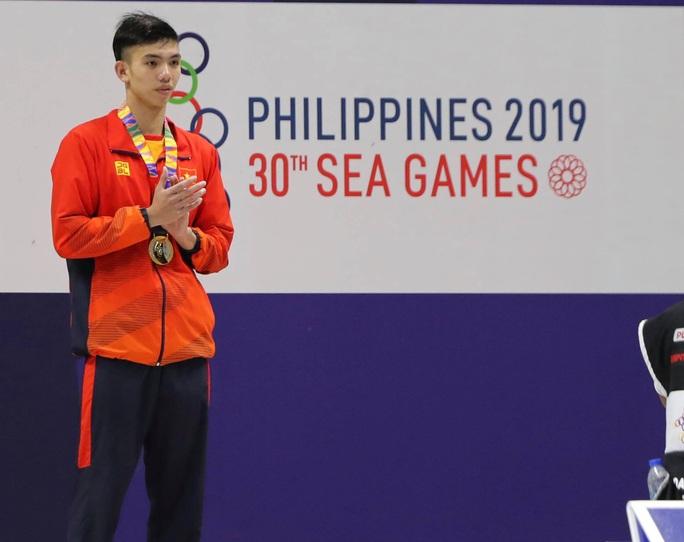 SEA Games 30: Huy Hoàng phá kỷ lục 400m tự do, lấy HCV đầu tiên môn bơi lội - Ảnh 6.