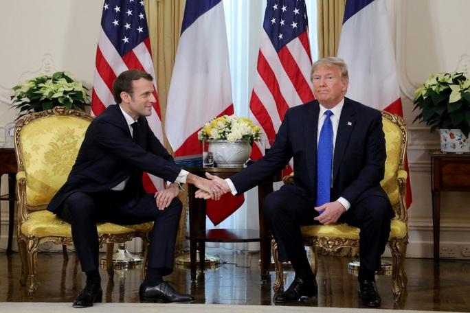 Hai ông Trump và Macron hục hặc, càng nghi ngờ về tương lai NATO - Ảnh 1.