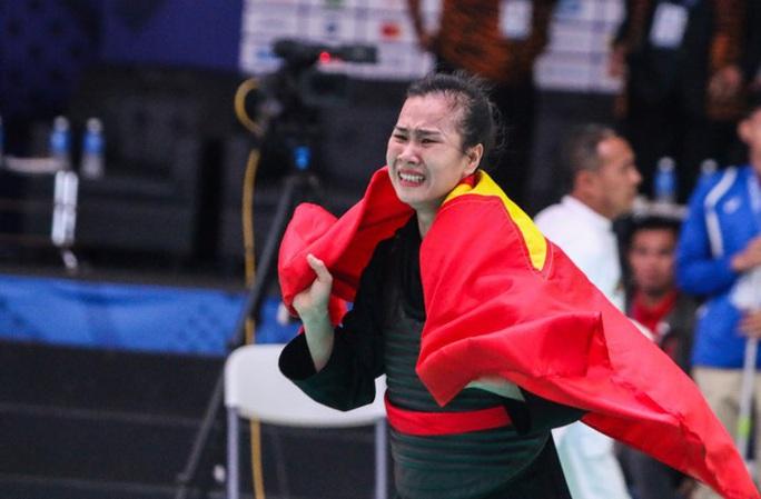 Nữ võ sĩ pencak silat xinh đẹp giành HCV SEA Games 30 cho Việt Nam - Ảnh 1.