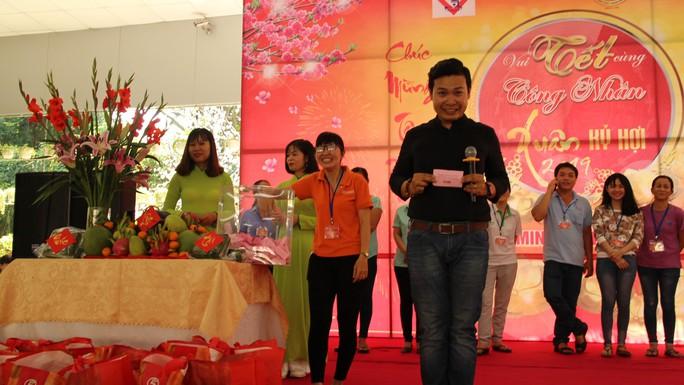 Lãnh đạo TP HCM vui Tết cùng công nhân - Ảnh 5.