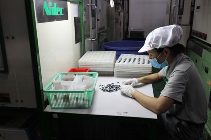 TP HCM: Công nhân phấn khởi trở lại làm việc sau Tết - Ảnh 1.