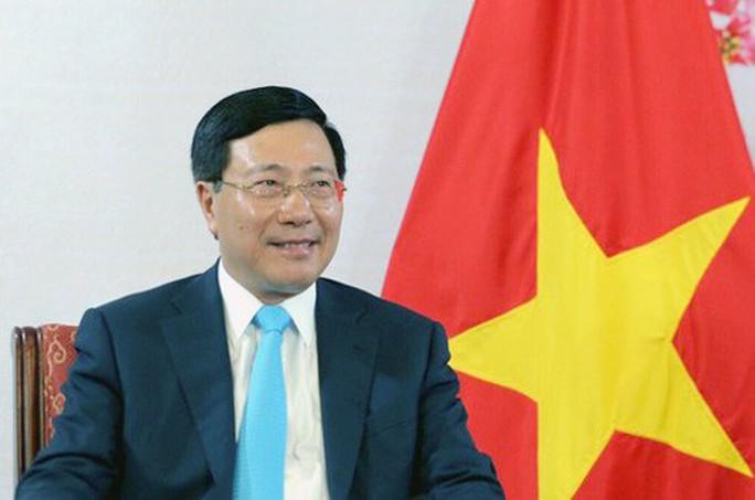 Phó Thủ tướng Phạm Bình Minh thăm Đức - Ảnh 1.