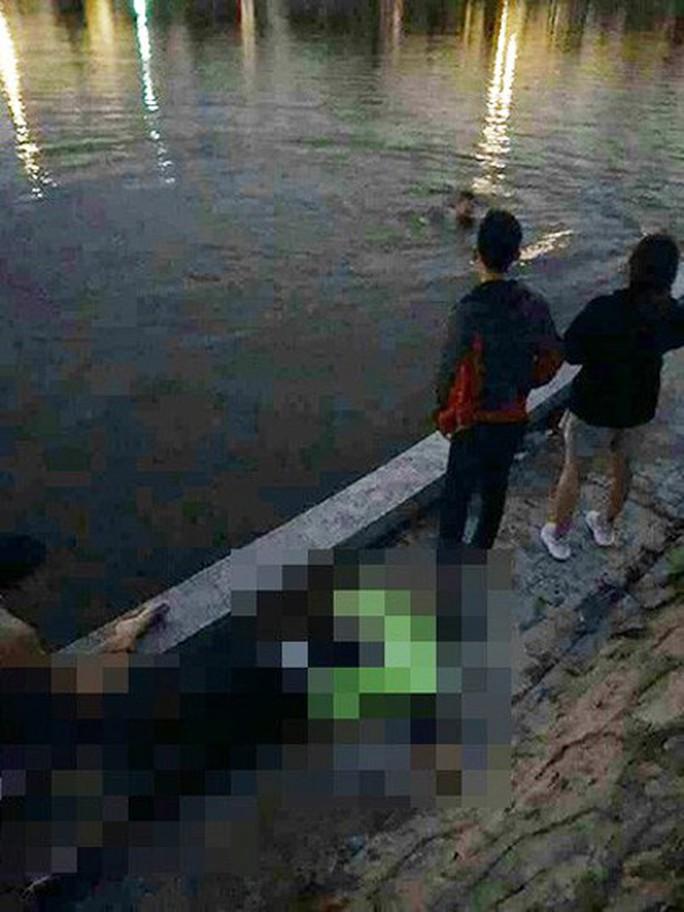 Đôi nam nữ cãi vã rồi nhảy xuống hồ điều hòa, 1 người tử vong - Ảnh 1.