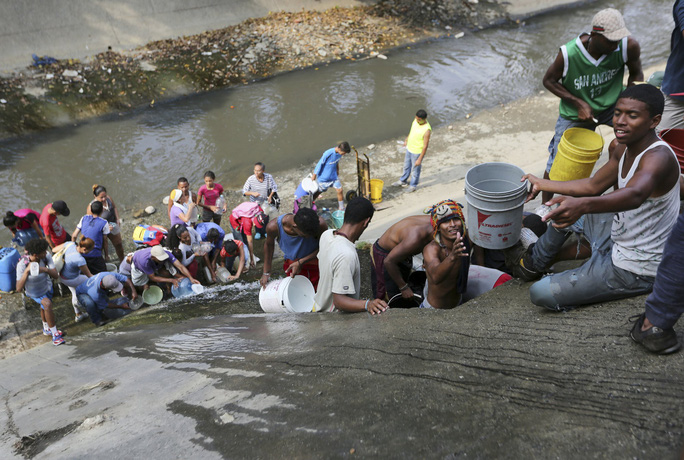 """Venezuela: Hỗn loạn gia tăng, bắt 2 nghi phạm """"phá hoại lưới điện"""" - Ảnh 6."""