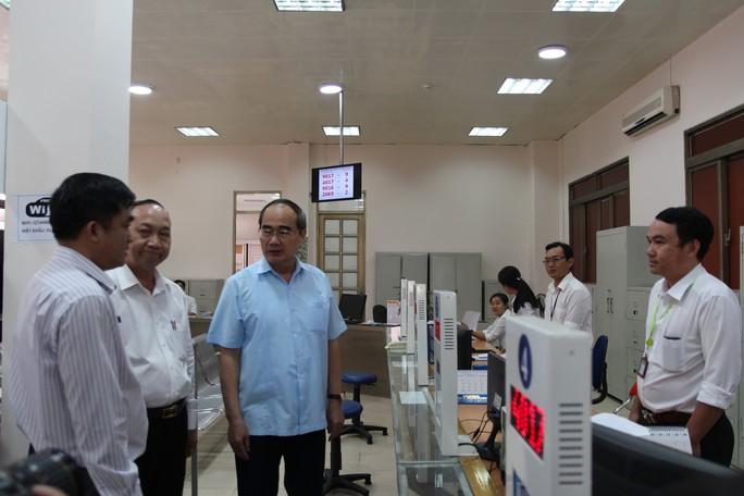 Bí thư Thành ủy TP HCM kết luận nhiều vấn đề nóng ở quận Tân Bình và quận 4 - Ảnh 1.