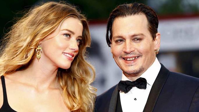 """""""Cướp biển"""" Johnny Depp kiện vợ cũ đòi 50 triệu USD - Ảnh 2."""