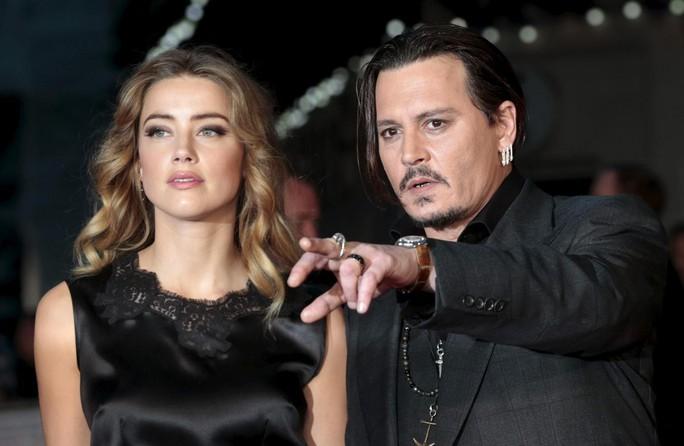 """""""Cướp biển"""" Johnny Depp kiện vợ cũ đòi 50 triệu USD - Ảnh 1."""