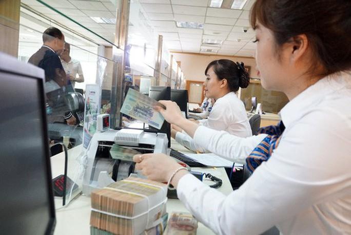 Lãi suất chứng chỉ tiền gửi ngân hàng đã lên xấp xỉ 9%/năm - Ảnh 1.