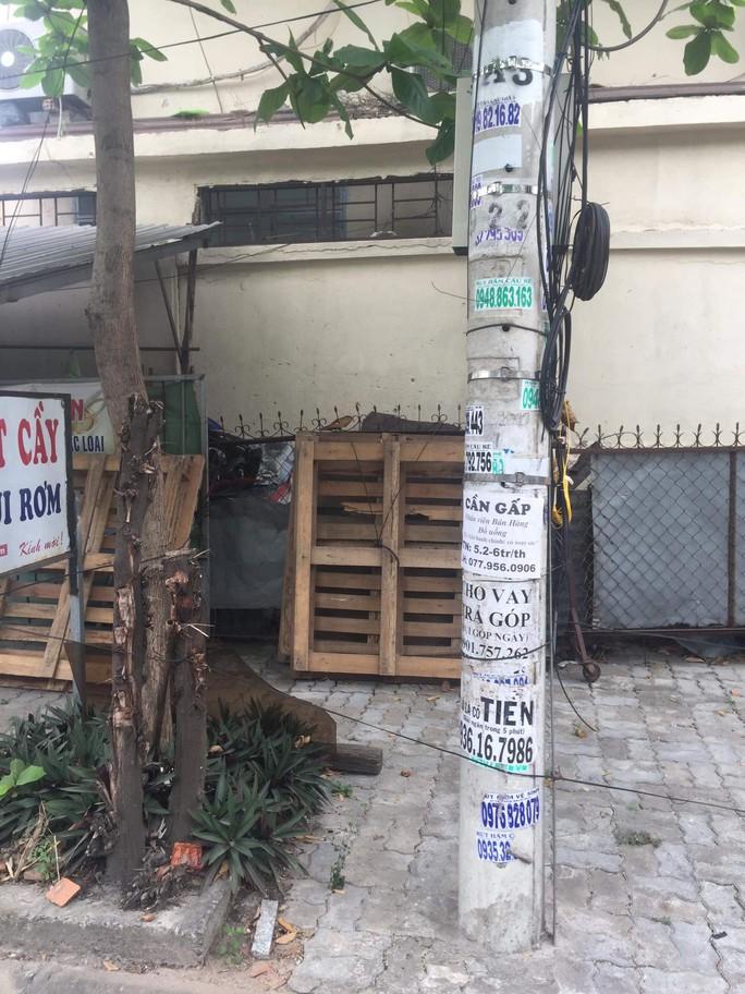 Nhếch nhác tờ rơi cho vay nặng lãi tràn lan trên đường phố Đà Nẵng - Ảnh 11.
