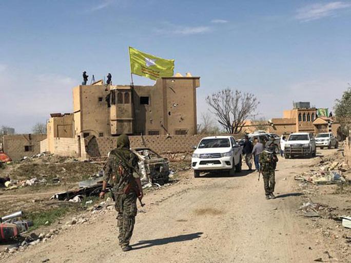 Mất hết lãnh thổ, IS vẫn là mối đe dọa lớn - Ảnh 1.