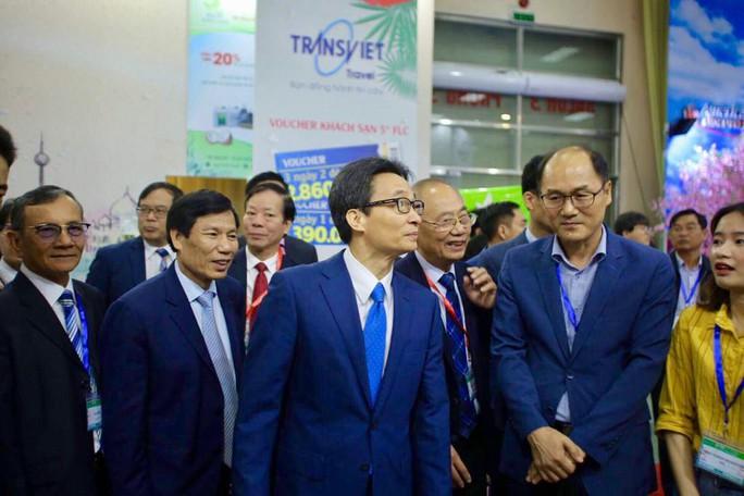 Phó Thủ tướng Vũ Đức Đam khai mạc Hội chợ Du lịch quốc tế VITM Hà Nội 2019 - Ảnh 4.